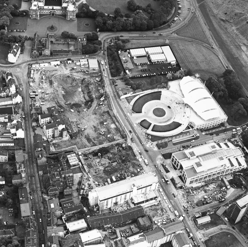 Oblique aerial view centred on the Scottish parliament under construction with `Our Dynamic Earth¿ adjacent, taken from the WSW.