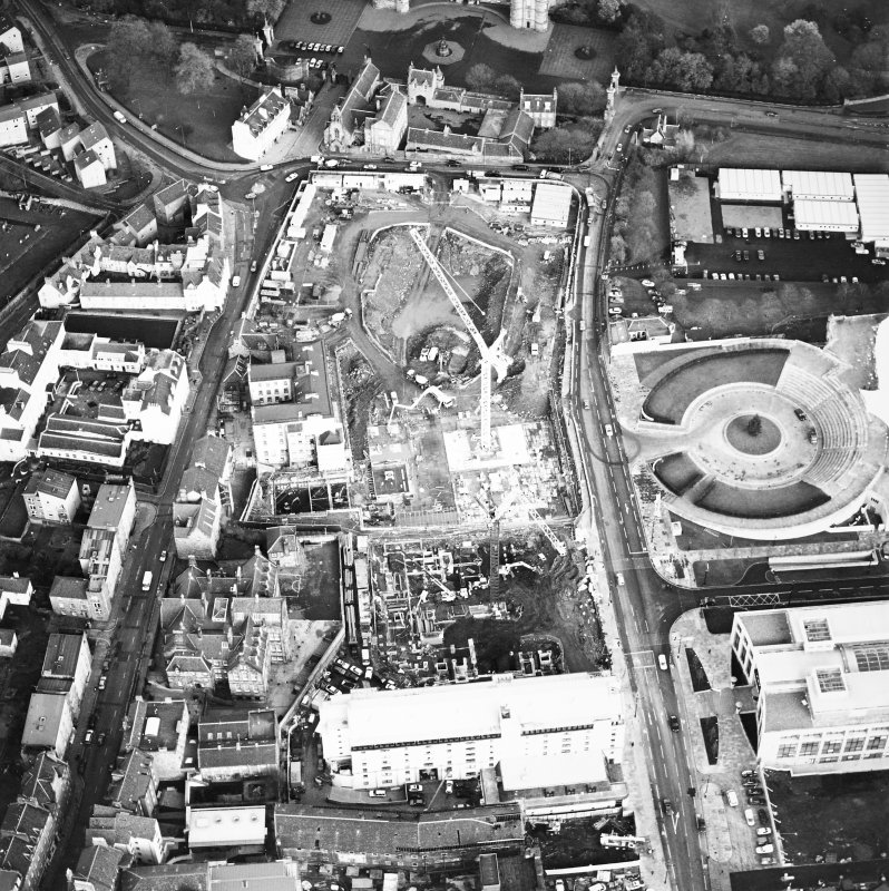 Oblique aerial view centred on the Scottish parliament under construction, taken from the SW.