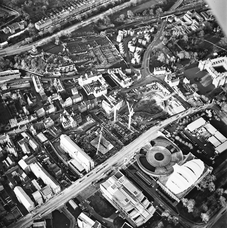 Oblique aerial view centred on the Scottish parliament under construction with `Our Dynamic Earth¿ adjacent, taken from the SSW.