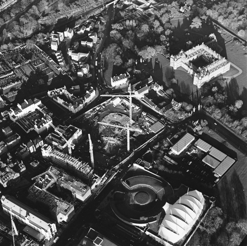 Oblique aerial view centred on the Scottish parliament under construction with `Our Dynamic Earth' and palace adjacent, taken from the SSW.