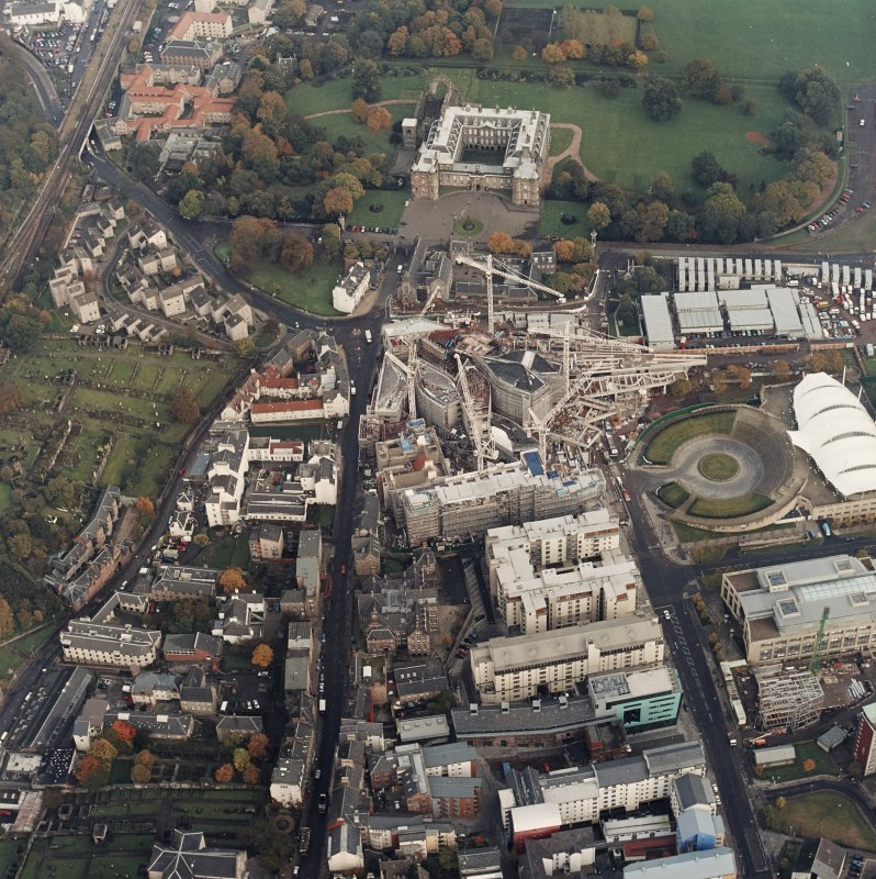 Oblique aerial view centred on the construction of the Scottish Parliament, with `Our Dynamic Earth¿ and Holyrood Palace adjacent, taken from the WSW.