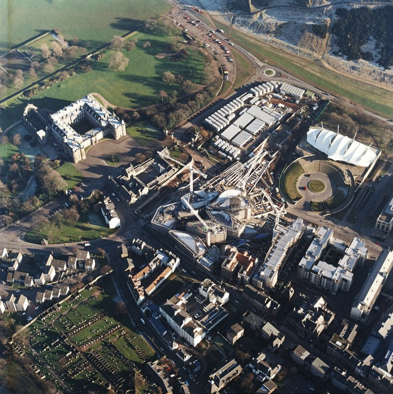 Oblique aerial view centred on the construction of the Scottish parliament, taken from the WNW.