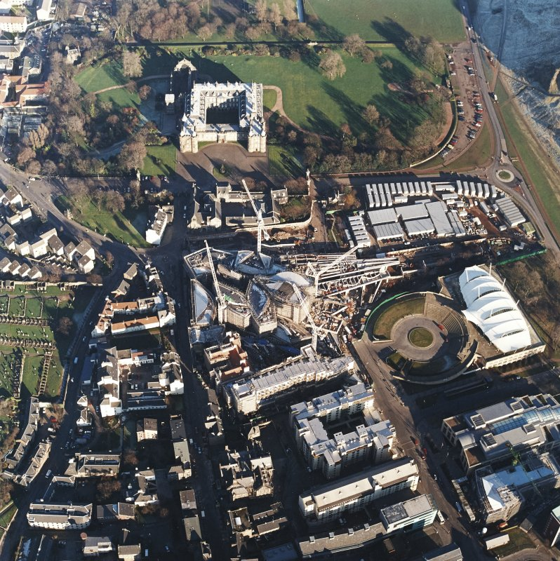 Oblique aerial view centred on the construction of the Scottish parliament, taken from the W.