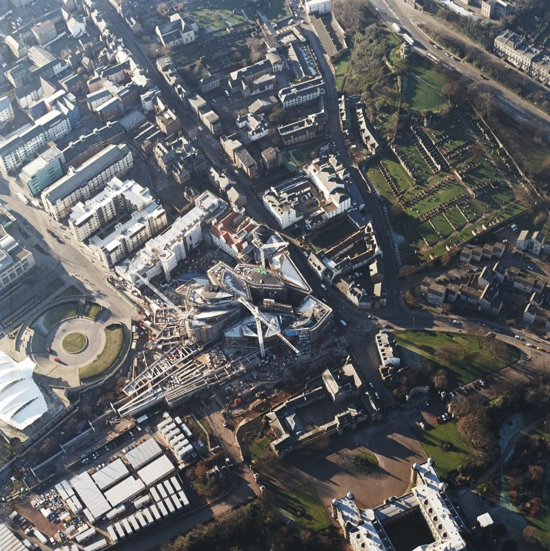 Oblique aerial view centred on the construction of the Scottish parliament, taken from the E.