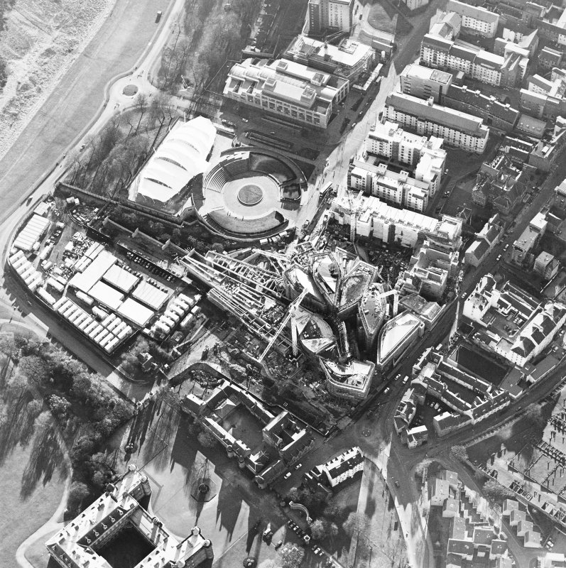 Oblique aerial view centred on the construction of the Scottish parliament, taken from the NE.