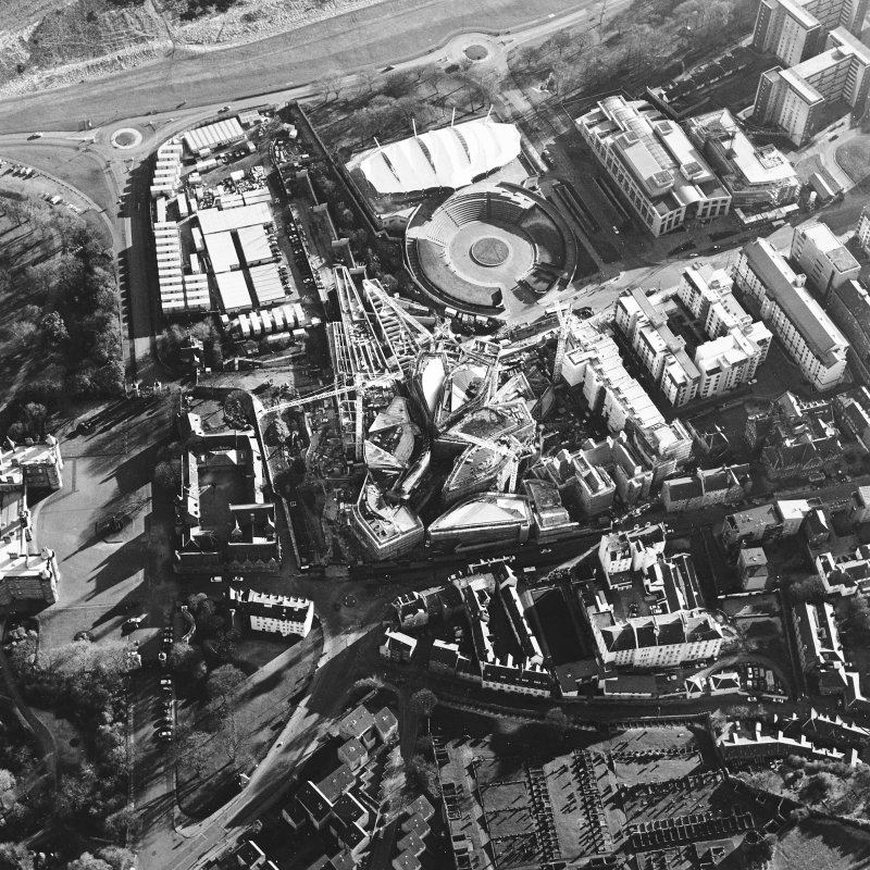 Oblique aerial view centred on the construction of the Scottish parliament, taken from the N.