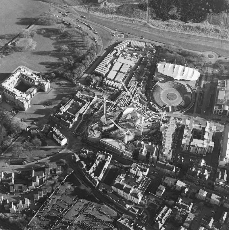 Oblique aerial view centred on the construction of the Scottish parliament, taken from the NW.