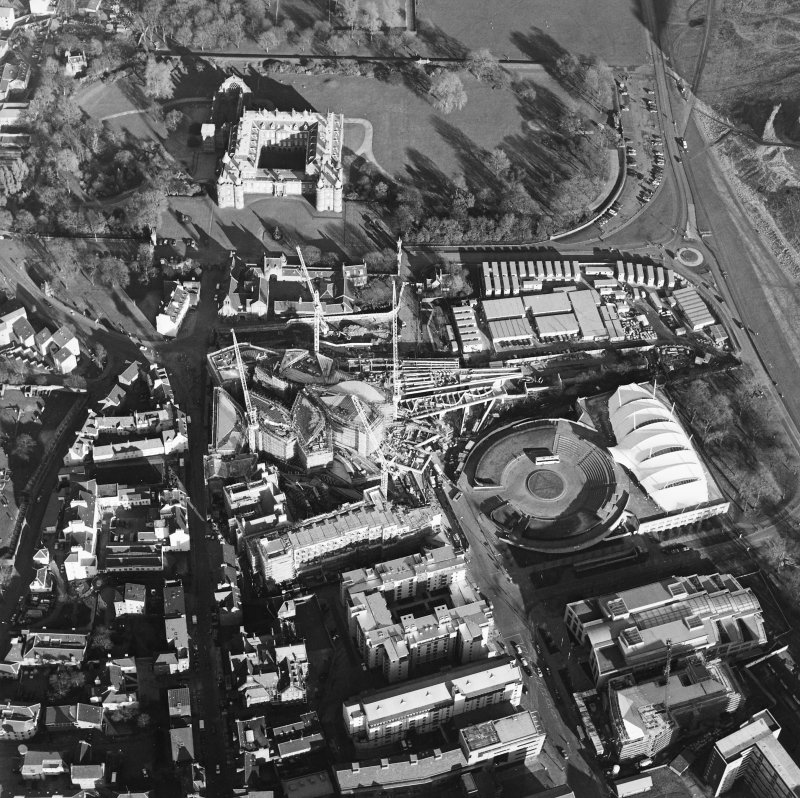 Oblique aerial view centred on the construction of the Scottish parliament, taken from the WSW.