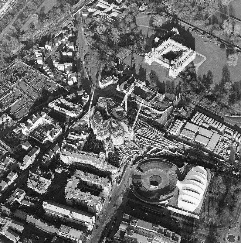 Oblique aerial view centred on the construction of the Scottish parliament, taken from the SW.