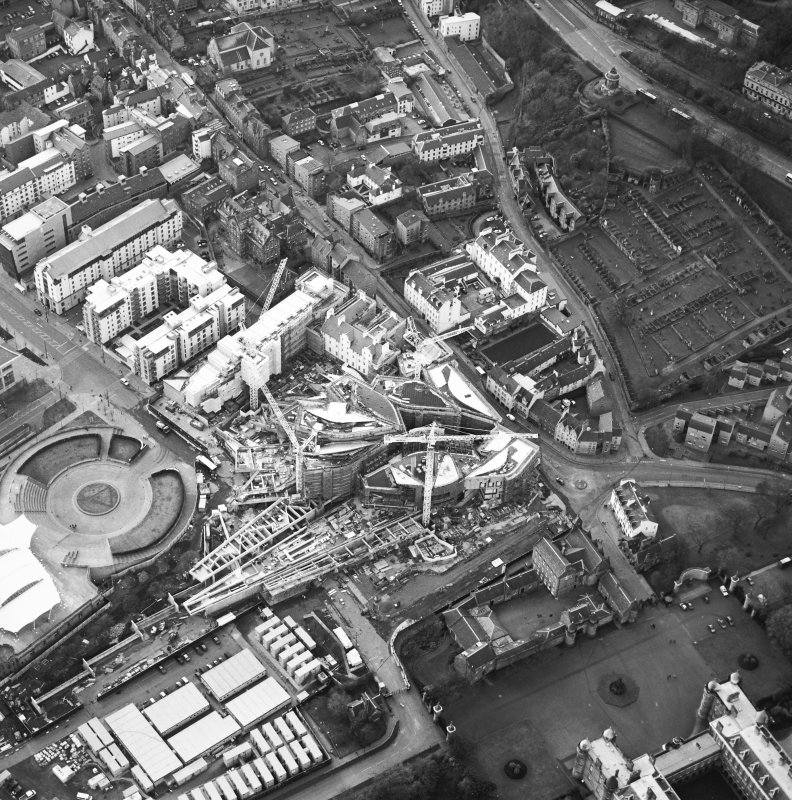 Oblique aerial view centred on the construction of the Scottish Parliament with exhibition centre adjacent, taken from the ESE.
