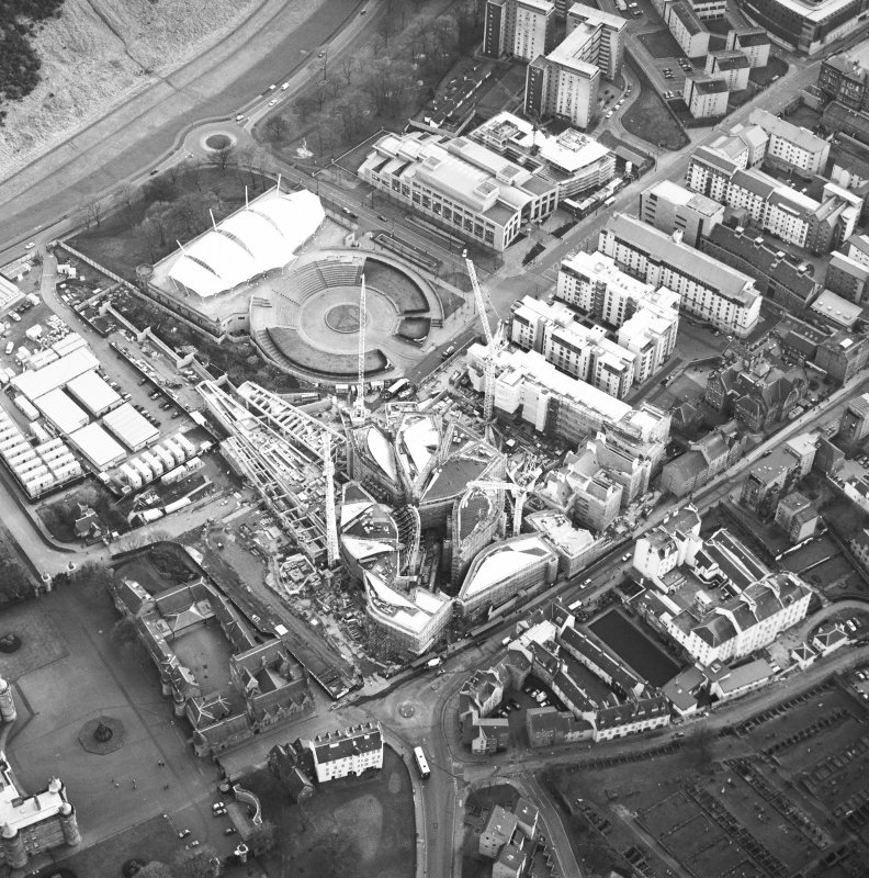 Oblique aerial view centred on the construction of the Scottish Parliament with exhibition centre adjacent, taken from the NNE.