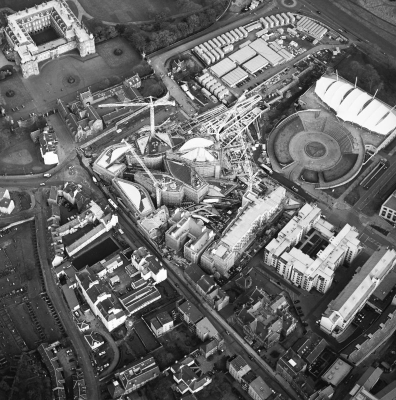 Oblique aerial view centred on the construction of the Scottish Parliament with exhibition centre adjacent, taken from the W.