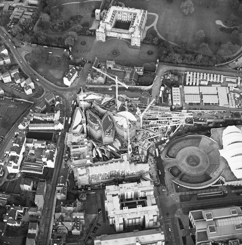 Oblique aerial view centred on the construction of the Scottish Parliament with exhibition centre and palace adjacent, taken from the WSW.