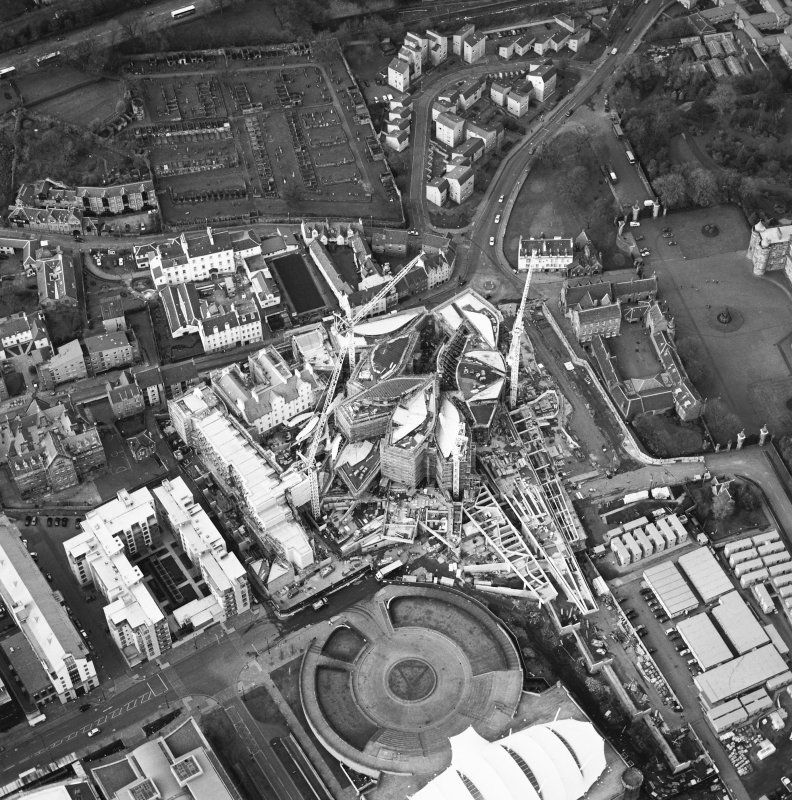 Oblique aerial view centred on the construction of the Scottish Parliament, taken from the S.