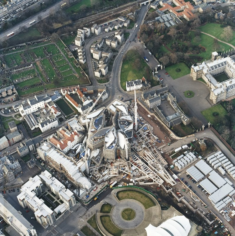 Oblique aerial view centred on the construction of the Scottish Parliament, taken from the SSW.