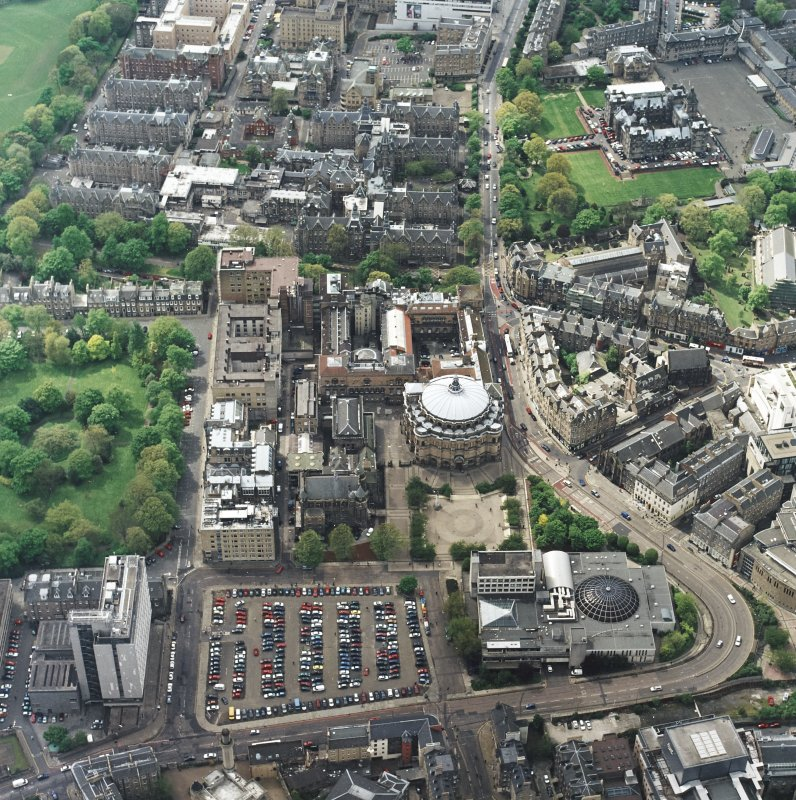Oblique aerial view centred on the hall with school, university, club, chapel, hospital and school adjacent, taken from the ENE.