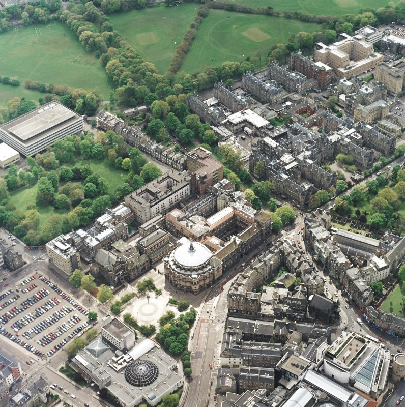 Oblique aerial view of the university centred on the hall with the hospital adjacent, taken from the NNE.