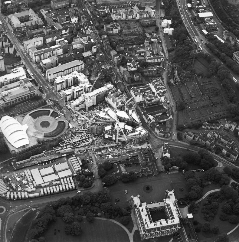 Oblique aerial view centred on the construction of the Scottish Parliament with the exhibition centre adjacent, taken from the E.