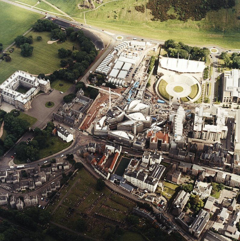 Oblique aerial view centred on the construction of the Scottish Parliament with the exhibition centre adjacent, taken from the NNW.
