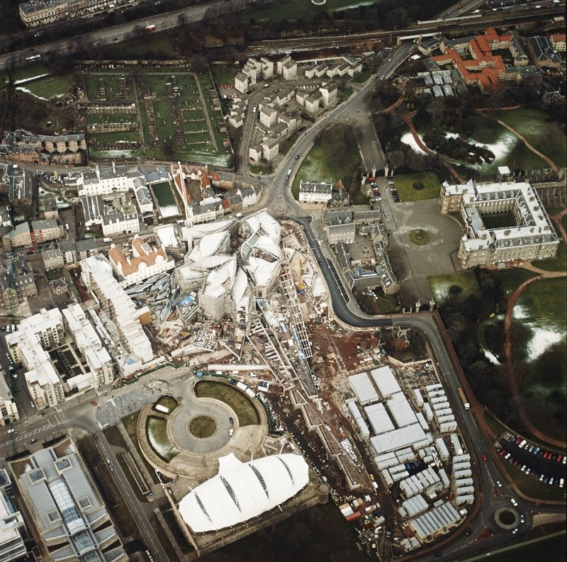 Oblique aerial view centred on the construction of the Scottish Parliament with `Our Dynamic Earth¿ and Holyrood Palace adjacent, taken from the SSE.