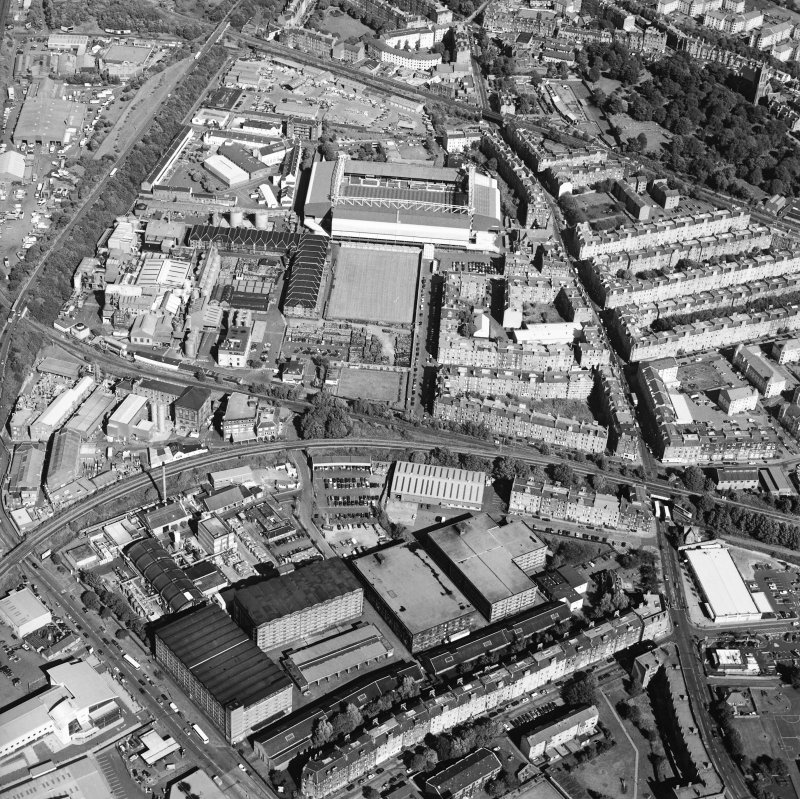 Oblique aerial view centred on the bonded warehouse with the football stadium adjacent, taken from the W.