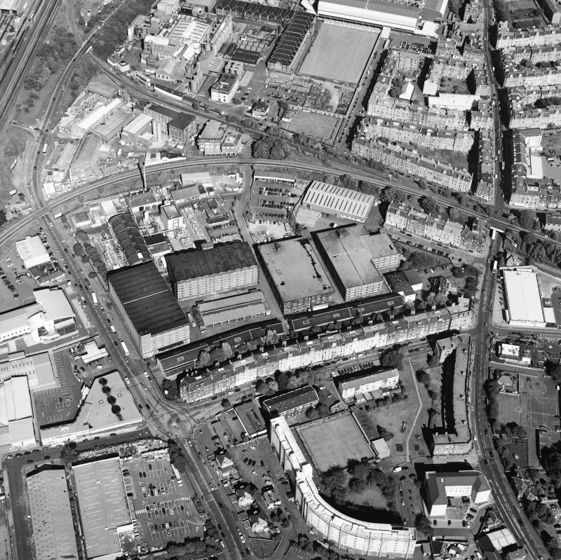 Oblique aerial view centred on the bonded warehouse with the park and bowling green adjacent, taken from the WSW.