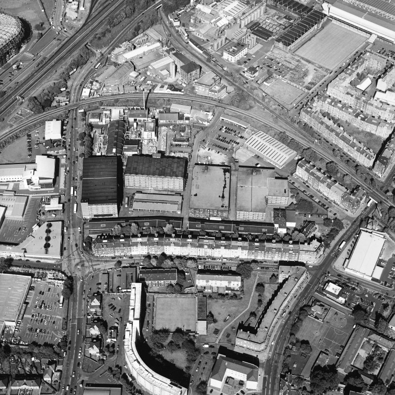 Oblique aerial view centred on the bonded warehouse with the park and bowling green adjacent, taken from the SW.