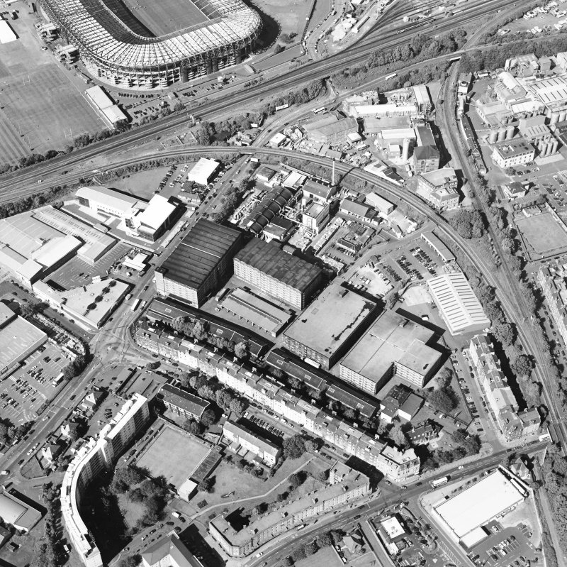 Oblique aerial view centred on the bonded warehouse with the park and bowling green adjacent, taken from the SSW.