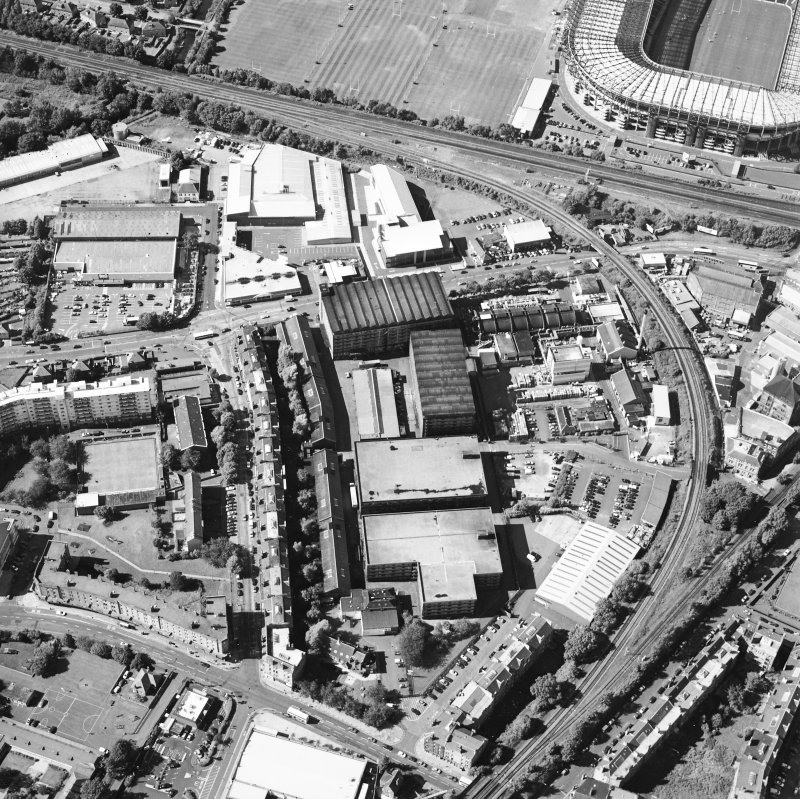 Oblique aerial view centred on the bonded warehouse with the park and bowling green adjacent, taken from the SE.