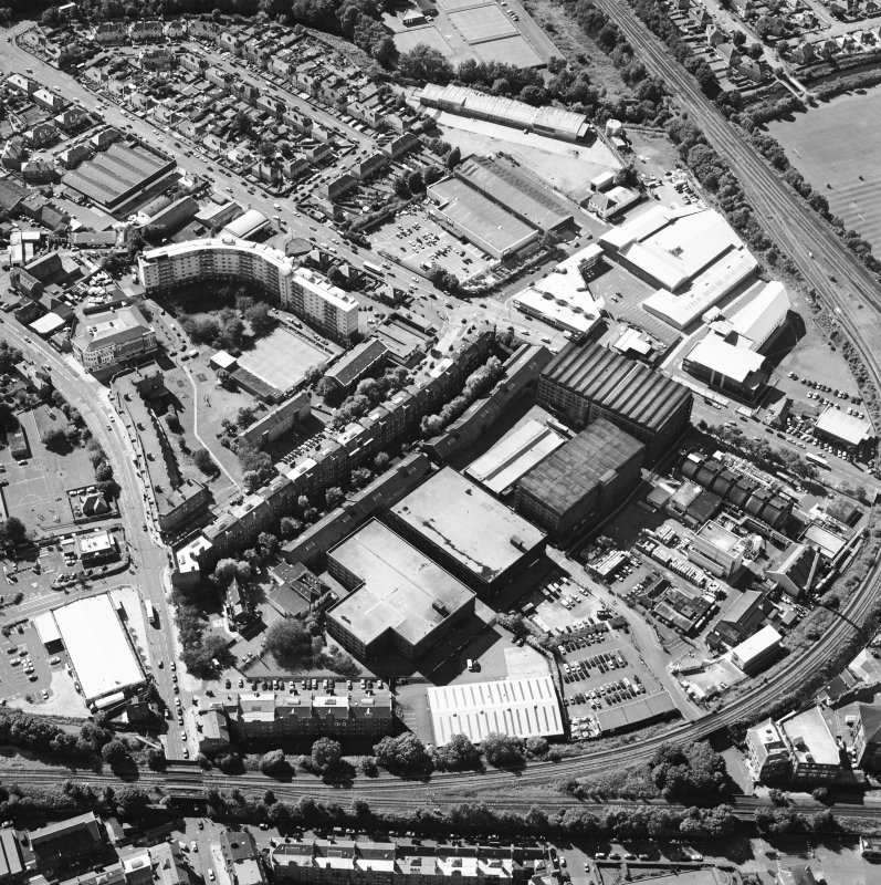 Oblique aerial view centred on the bonded warehouse with the park and bowling green adjacent, taken from the E.