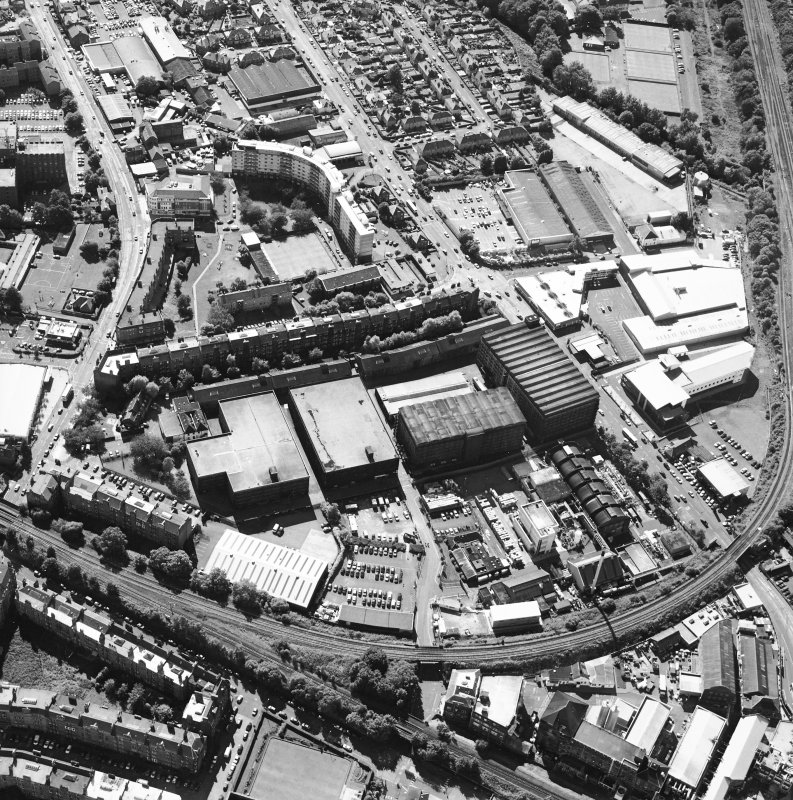 Oblique aerial view centred on the bonded warehouse with the park and bowling green adjacent, taken from the ENE.