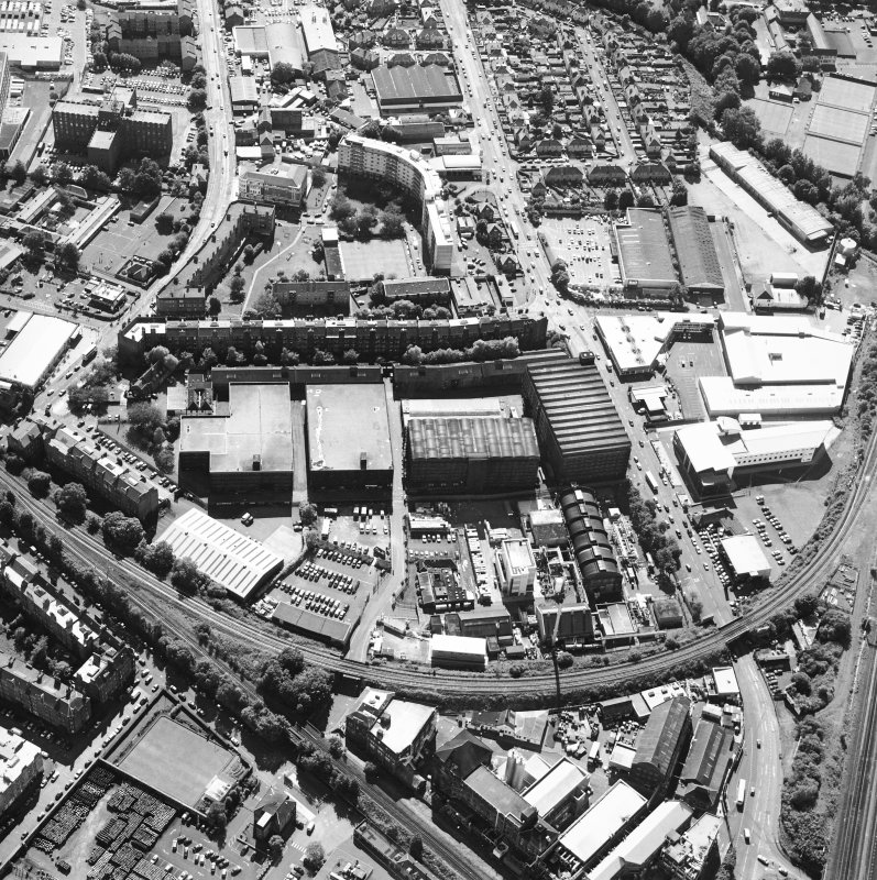 Oblique aerial view centred on the bonded warehouse with the park and bowling green adjacent, taken from the NE.