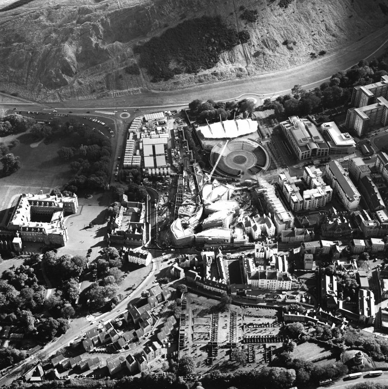 Oblique aerial view centred on the construction of the Scottish Parliament with the exhibition centre and palace adjacent, taken from the NNW.