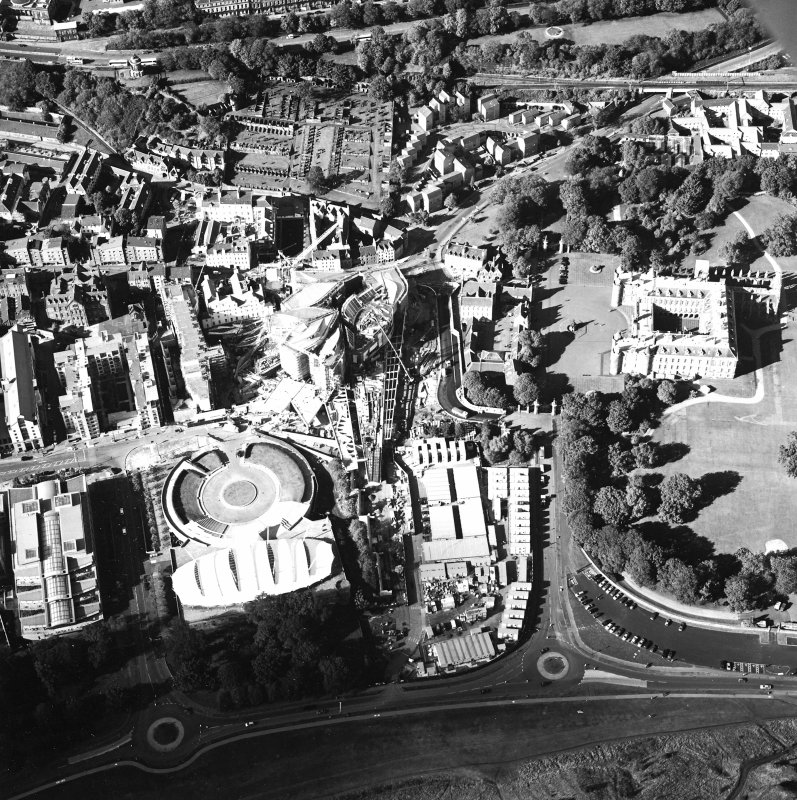 Oblique aerial view centred on the construction of the Scottish Parliament with the exhibition centre and palace adjacent, taken from the SSE.