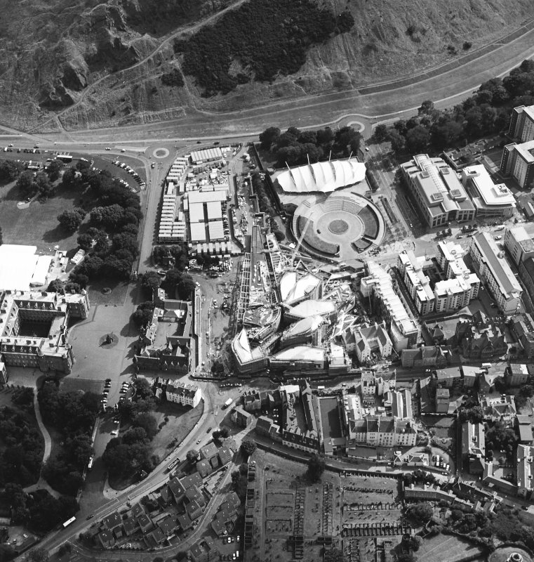 Oblique aerial view centred on the construction of the Scottish Parliament with Our Dynamic Earth, Queensbury House and Holyrood Palace adjacent, taken from the N.