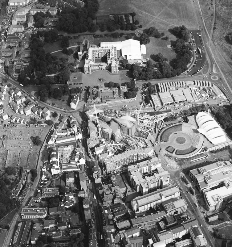 Oblique aerial view centred on the construction of the Scottish Parliament with Our Dynamic Earth, Queensbury House and Holyrood Palace adjacent, taken from the W.