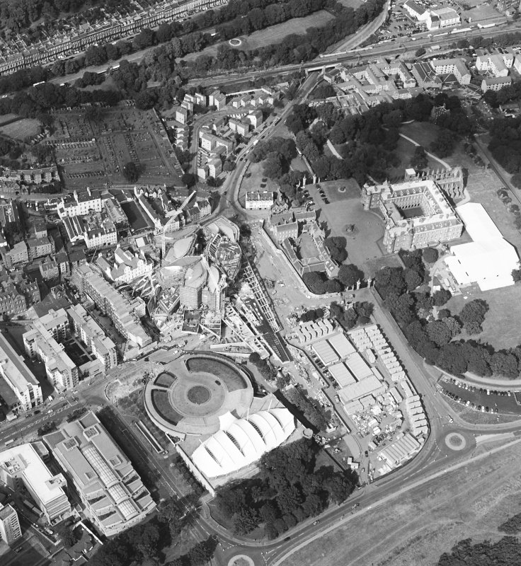 Oblique aerial view centred on the construction of the Scottish Parliament with Our Dynamic Earth, Queensbury House and Holyrood Palace adjacent, taken from the SW.