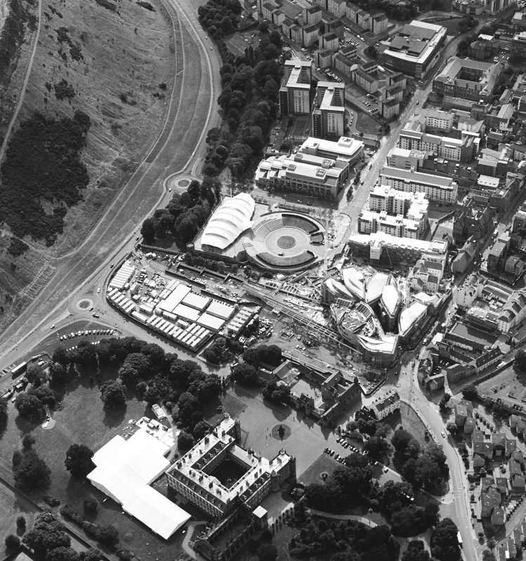 Oblique aerial view centred on the construction of the Scottish Parliament with Our Dynamic Earth, Queensbury House and Holyrood Palace adjacent, taken from the ENE.