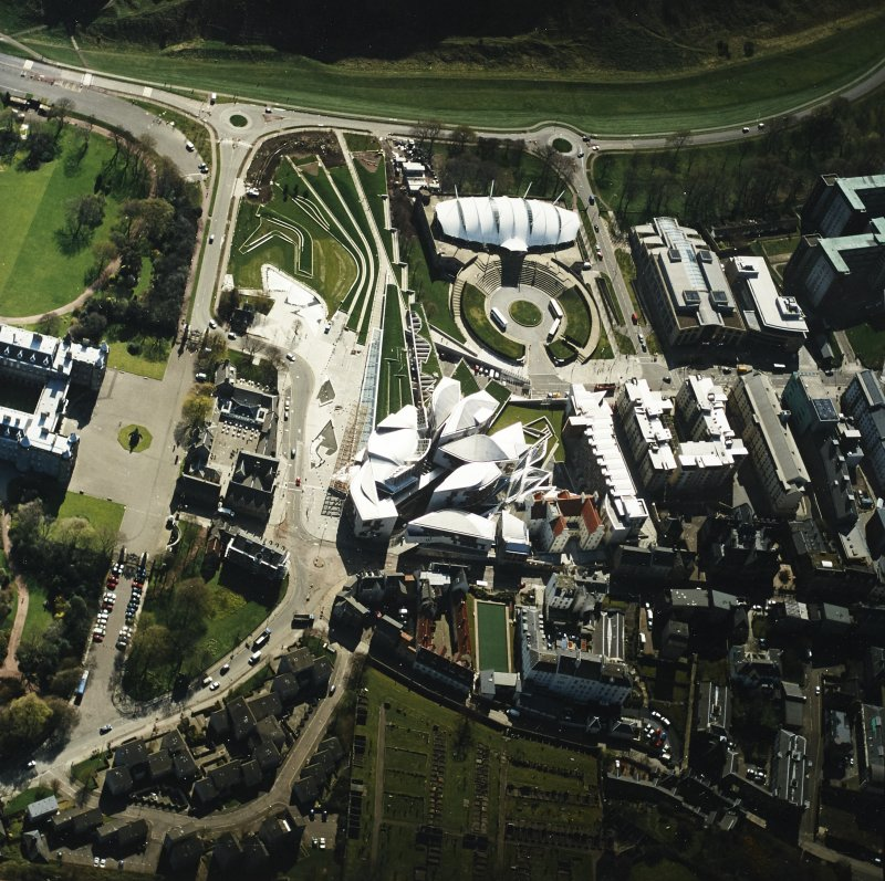 Oblique aerial view centred on the Scottish Parliament building with the exhibition centre adjacent, taken from the NNW.
