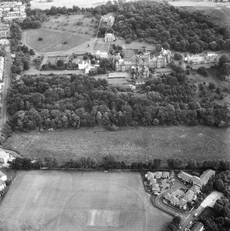 Oblique aerial view centred on Craig House, Old Craig House, South Craig Villa, Bevan House, East Craig and Queen's Craig.