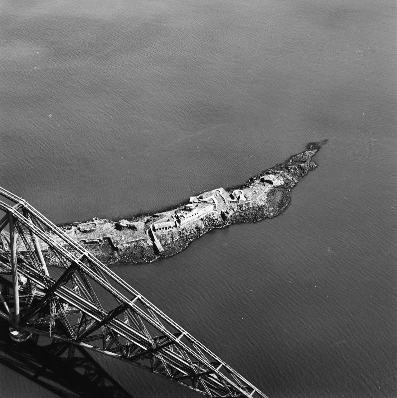 Oblique aerial view of The Forth Bridge and Inch Garvie centred on the rail bridge and the remains of a castle, battery, coast battery and artillery fortifications, taken from the SW.