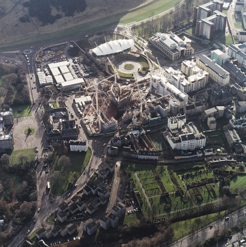 Oblique aerial view centred on the construction of the Scottish Parliament with `Our Dynamic Earth and Queensberry House adjacent, taken from the N.