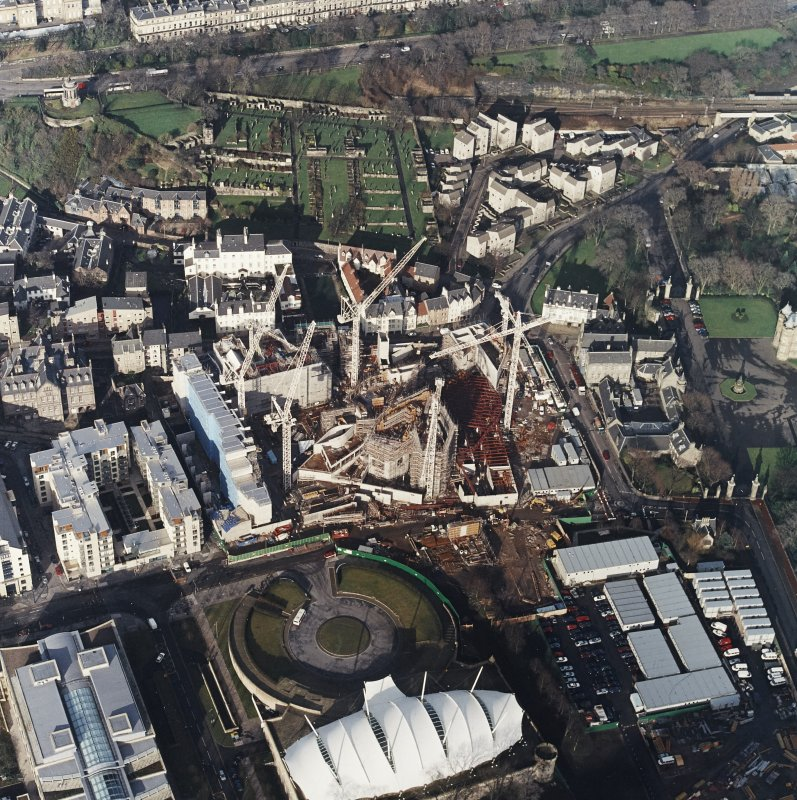 Oblique aerial view centred on the construction of the Scottish Parliament with `Our Dynamic Earth and Queensberry House adjacent, taken from the SSE.