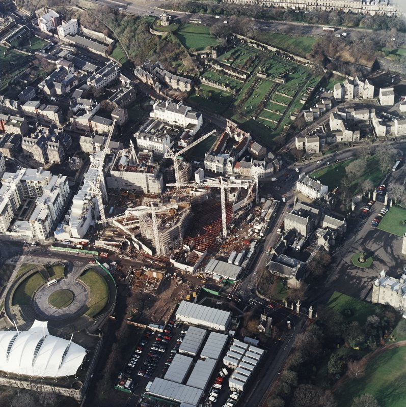 Oblique aerial view centred on the construction of the Scottish Parliament with `Our Dynamic Earth and Queensberry House adjacent, taken from the SE.
