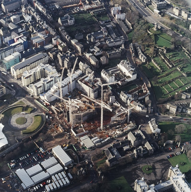 Oblique aerial view centred on the construction of the parliament building, taken from the E.