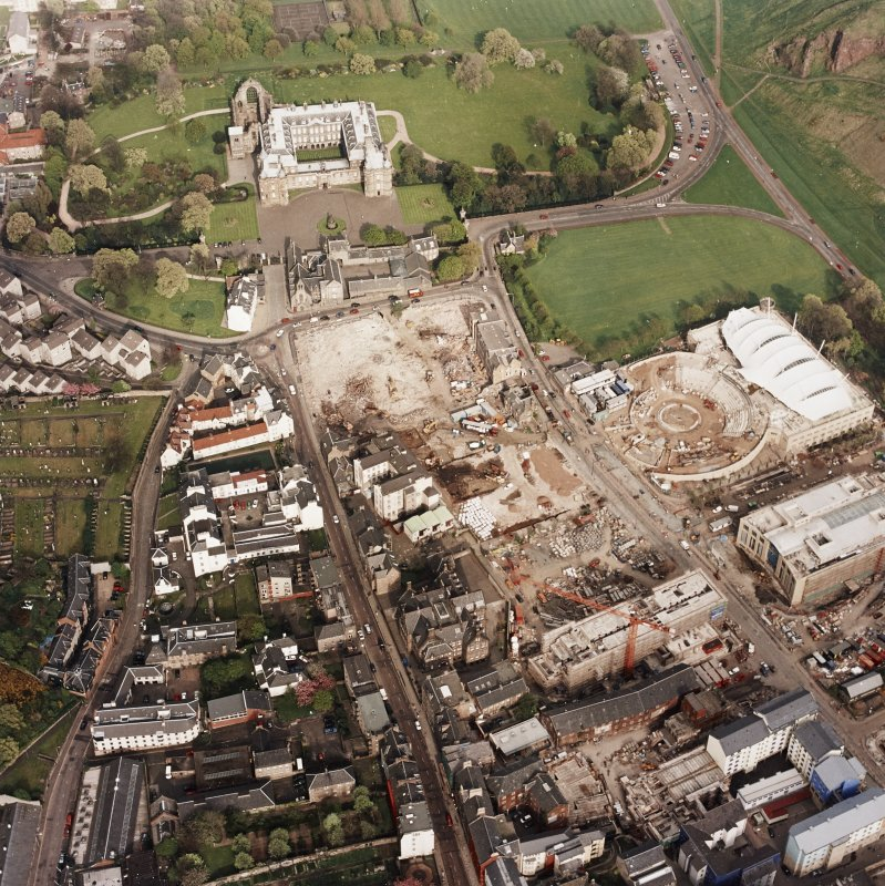Oblique aerial view of Edinburgh centred on the construction of the Scottish Parliament with the 'Our Dynamic Earth' building and Holyrood Palace adjacent, taken from the W.
