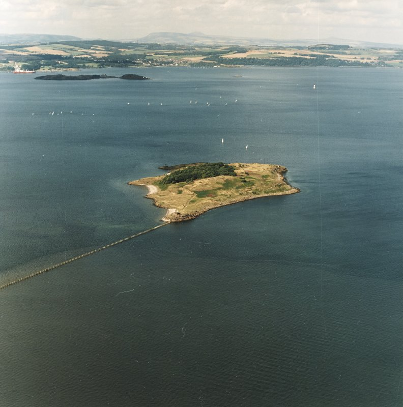 General oblique aerial view looking across Cramond Island towards Inchcolm Abbey and Aberdour, taken from the SE.