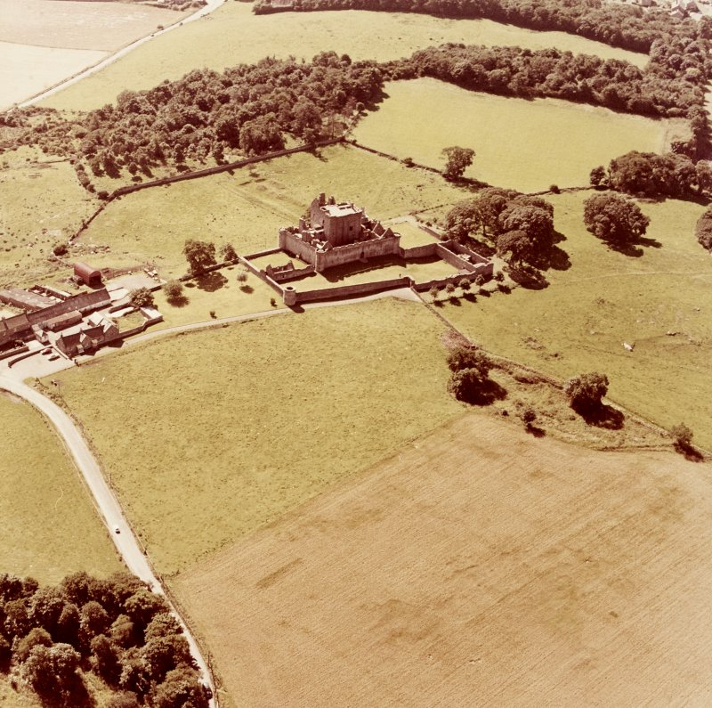 Oblique aerial view from North East of Craigmillar Castle and Mains
