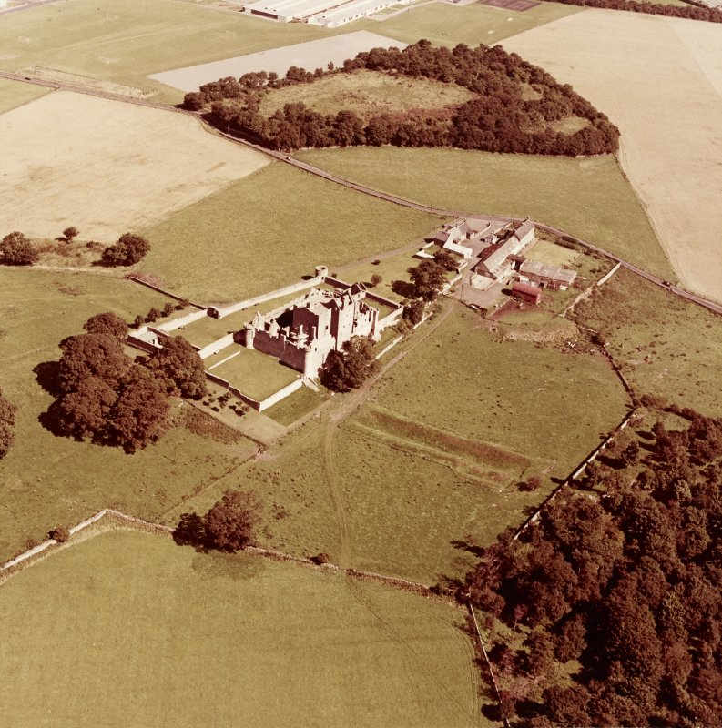 Oblique aerial view from South West of Craigmillar Castle and Mains