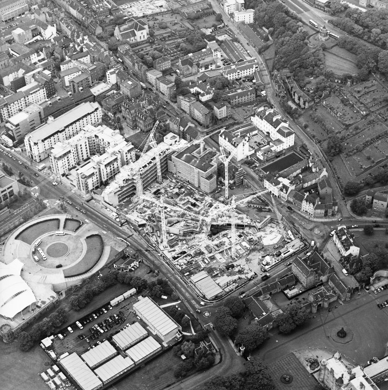 Oblique aerial view centred on the construction of the Scottish Parliament with the exhibition centre adjacent, taken from the ESE.